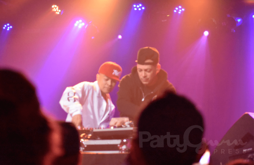 DJ Z-Trip & DJ Q-Bert sharing a turntable and a moment at Cervantes Masterpiece Ballroom.
